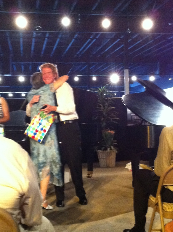 My son getting a hug from his piano teacher for a beautifully played Clair de Lune.