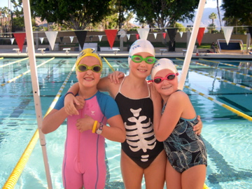 My daughter and lifetime friends, enjoying life on their swim team.