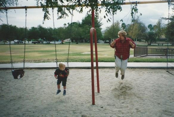 Grandma on the swings with Robert.